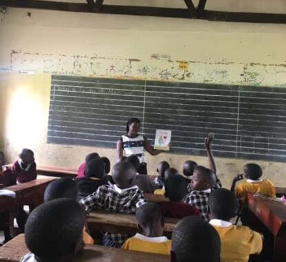 Kate Eldean Classroom book reading in Uganda of Gracie Brave | Mindstir Media Book Cover